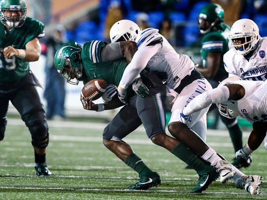 University of Memphis defender Christian Johnson (right)  sacks Tulane University quarterback Jonathan Banks (left) during second quarter action in Memphis, Tenn., Friday, October 27, 2017.