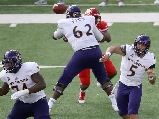 Nov 4, 2017; Houston, TX, USA; East Carolina Pirates quarterback Gardner Minshew (5) completes a pass against the Houston Cougars in the first half at TDECU Stadium. Mandatory Credit: Thomas B. Shea-USA TODAY Sports