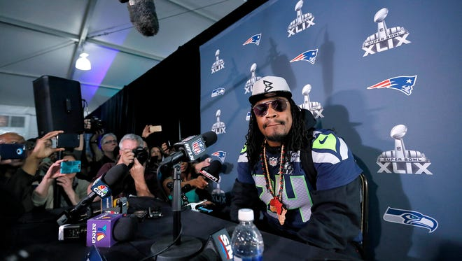 Seattle Seahawks' Marshawn Lynch attends a news conference for NFL Super Bowl XLIX football game, Wednesday, Jan. 28, 2015, in Phoenix. The Seahawks play the New England Patriots in Super Bowl XLIX on Sunday, Feb. 1, 2015.
