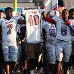 The Franklin Parish and Sterlington Panthers come out together carrying the jersey of Franklin Parish fallen teammate Tyrell Cameron prior to the Patriots' game against the Wossman Wildcats earlier this season. Louisiana lawmakers are calling for a study into the deaths of high-school football players.
