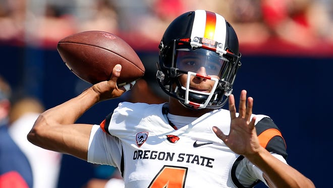 Oregon State quarterback Seth Collins (4) warms up before an NCAA college football game against Arizona, Saturday, Oct. 10, 2015, in Tucson, Ariz.