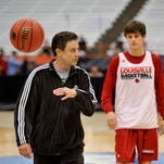 Louisville coach Rick Pitino tossed the ball aside while coaching practice at the Carrier Dome.  His team will face North Carolina State in the NCAA Sweet Sixteen Friday night at the Carrier Dome in Syracuse, NY. March 26, 2015.