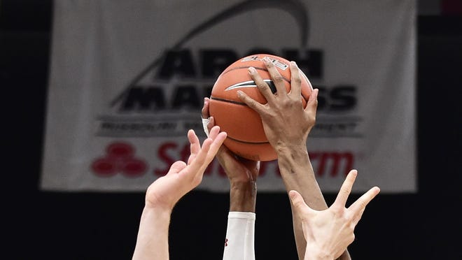 Bradley Braves forward Elijah Childs (10) and Valparaiso Crusaders forward John Kiser (33) reach for a rebound during the second half of the Missouri Valley Conference Tournament at Enterprise Center.