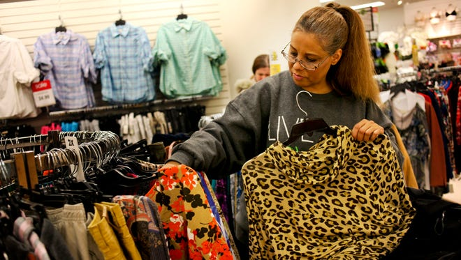 Port Huron resident Miriam Eberhardt looks over clothing at Carson's in Fort Gratiot for job search workshops last year. Women can participate in interview- and job-prep workshops at St. Clair County Community College and Literacy and More in February.