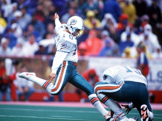 Pete Stoyanovich kicks a field goal during a 1993 Miami Dolphins victory over the Buffalo Bills at Rich Stadium.