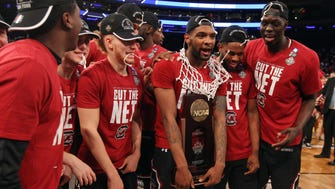 South Carolina Gamecocks guard Sindarius Thornwell (0) and his teammates celebrate with the trophy after beating the Florida Gators in the Elite Eight.