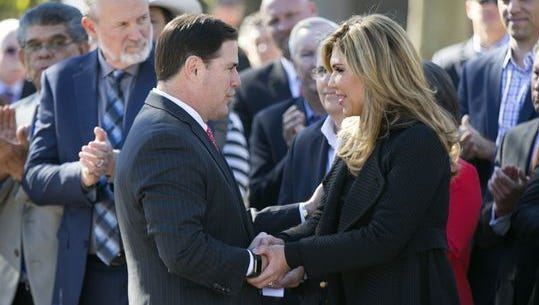 Gov. Doug Ducey shakes hands with the governor of Sonora, Mexico, Claudia Pavlovich Arellano, at the Capitol in Phoenix on Nov. 29, 2016. Parts for Lucid Motors' electric vehicles would be manufactured by suppliers in Sonora.