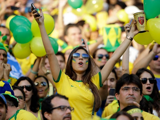 A brazil fan cheers before the World Cup quarterfinal soccer match between Brazil and Colombia at the Arena Castelao in Fortaleza, Brazil, Friday, July 4, 2014. (AP Photo/Hassan Ammar)