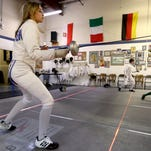 Olivia Merten (from left), 16, of Corvallis, Ian Clingerman, 13, of Keizer, and Justin Gonzalez, 12, of Salem, warm-up at the Salem Fencing Club on Wednesday, March 25, 2015.