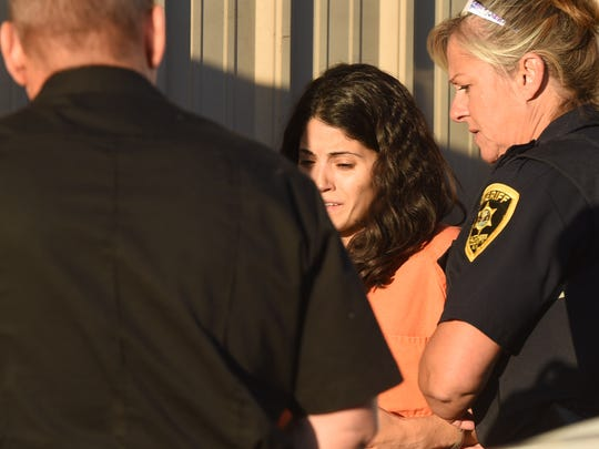 Nicole Addimando, center, arrives at Town of Poughkeepsie Justice Court.