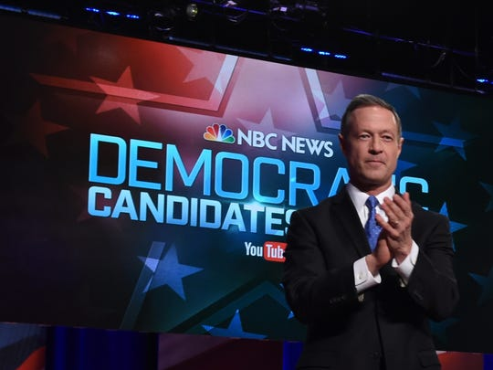 Martin O'Malley arrives on stage for the Democratic