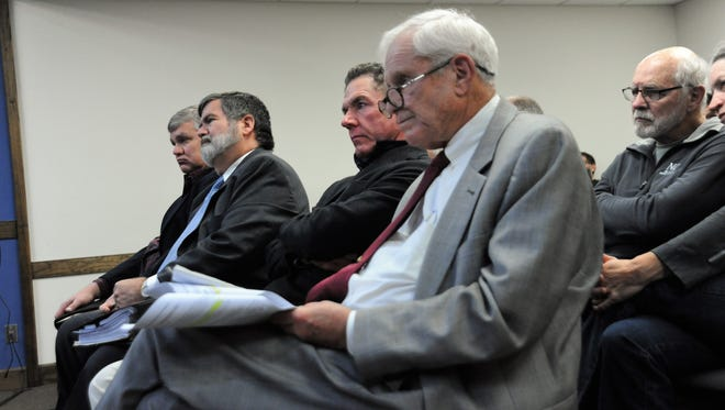Asheville attorney Albert Sneed, St. Louis attorney Joe Cordell, Black Mountain attorney Mike Begley and local architect Maury Hurt look on the Zoning Board of Adjustments considers Cordell's appeal.