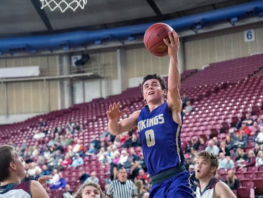 North Kitsap's Zac Olmsted goes to the basket against
