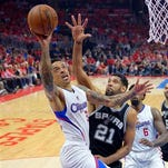 FILE - In this May 2 2015, file photo, Los Angeles Clippers forward Matt Barnes, left, shoots as San Antonio Spurs forward Tim Duncan defends during the first half of Game 7 in a first-round NBA basketball playoff series in Los Angeles. A person familiar with the situation says the Memphis Grizzlies have acquired Barnes from the Charlotte Hornets for guard Luke Ridnour. The person spoke to The Associated Press on condition of anonymity Thursday, June 25, 2015. because the trade hasn't been announced.  (AP Photo/Mark J. Terrill, File)