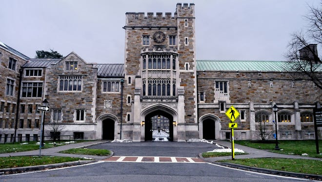 The main entrance to Vassar College is on Raymond Avenue in the Town of Poughkeepsie. The college's Main Building is visible through the archway.