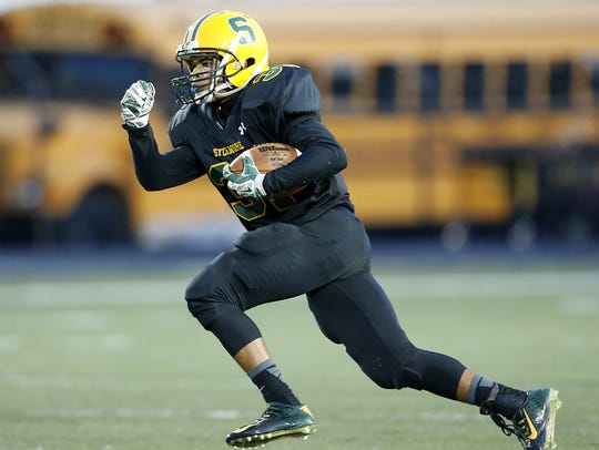 Sycamore defensive back Christian Kelly returns a kick