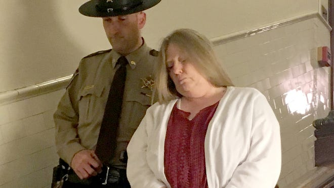 Tina Matheny is shown being escorted out of the Augusta County Courthouse in December following her conviction for second-degree murder.