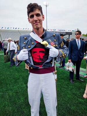 """In this May 2016 photo provided by Spenser Rapone, Rapone displays a shirt bearing the image of socialist icon Che Guevara under his uniform, after graduating from the United States Military Academy at West Point, N.Y. After Rapone, who was already a combat veteran after serving with the First Ranger Battalion in Afghanistan, posted the photo on Facebook, the Army dismissed him with an """"other than honorable"""" discharge."""