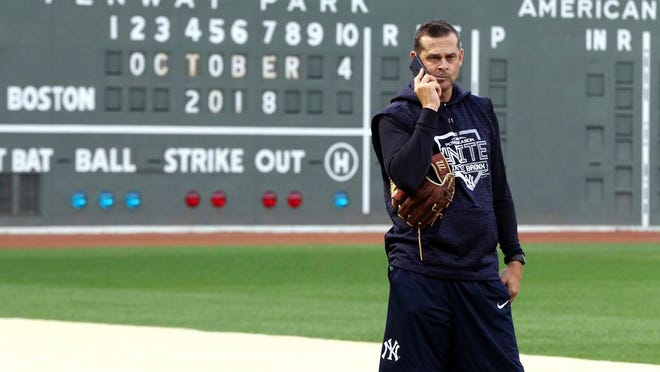 New York Yankees manager Aaron Boone talks on his phone with his players and staff every day during the coronavirus shutdown.