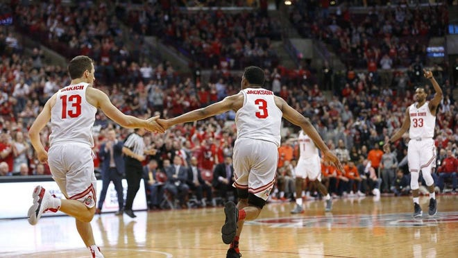 Ohio State guards C.J. Jackson (3) and Andrew Dakich.
