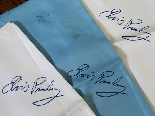 Pat Patterson still has the 3 scarves with Elvis Presley's autograph stamped on them that were given to her and her family after Elvis flew into the Smyrna airport to perform at a concert at Murphy Center in the 70's. Photo taken on Thursday, Aug. 10, 2017.