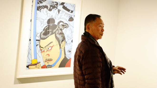 George Takei views the Roger Shimomura exhibit at the Hallie Ford Museum of Art at Willamette University. He recalled his childhood imprisonment in a World War II internment camp.
