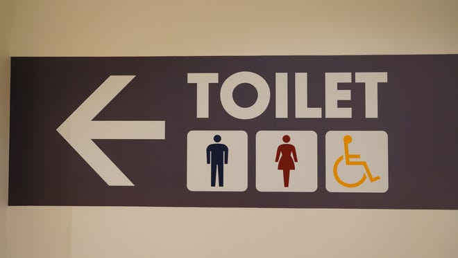 An employer says its restrooms are not required to have handicap stalls. What can the letter writer do?