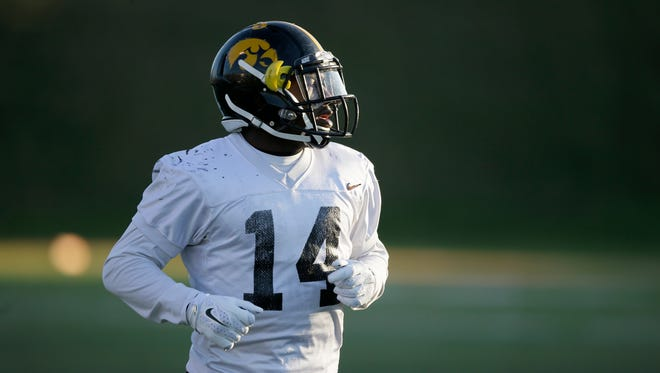 In this April 8, 2016, file photo, Iowa's Desmond King runs on the field during spring NCAA college football practice in West Des Moines, Iowa.
