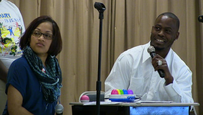 NFL veteran quarterback Tarvaris Jackson and MacMillan Elementary Faith Goshay competed in a Family-Feud style competition Monday morning about Dr. Seuss.