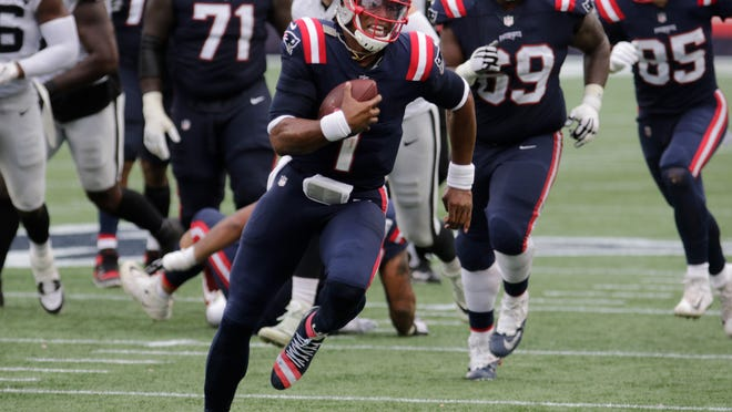 Patriots quarterback Cam Newton scrambles out of the pocket in the fourth quarter of Sunday's game against Las Vegas.