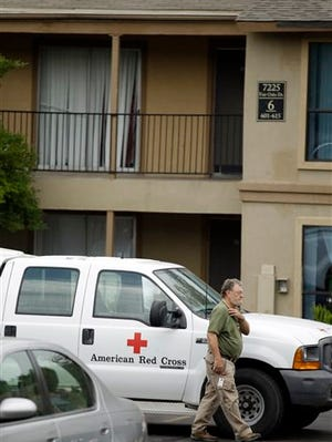 A Red Cross representative arrives at The Ivy Apartments complex, Thursday, Oct. 2, 2014, in Dallas. The Red Cross and North Texas Food Bank delivered food items and supplies to a unit at the complex where a family who had contact with a man diagnosed with the Ebola virus reside. Dallas officials have asked the family to remain in their home. (AP Photo/Tony Gutierrez)