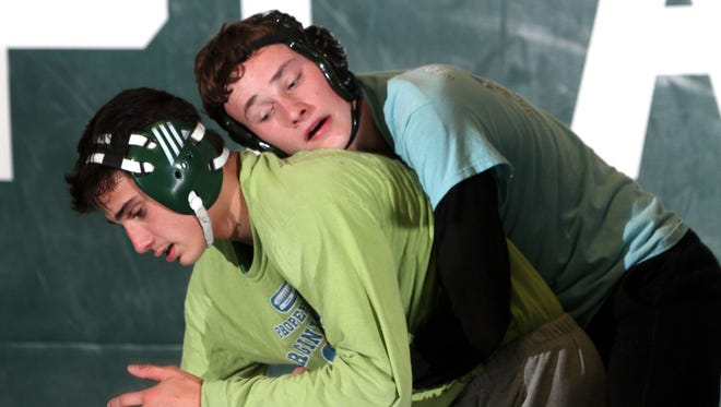 Dan Hedden, left, and Ryan Walsh in action at wrestling practice at South Plainfield High School.