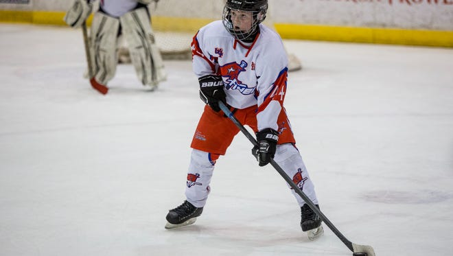 Port Huron Flyers' Dan Beauchamp looks to pass during a Silver Stick PeeWee A hockey game Thursday, Jan. 19, 2017 at McMorran Arena.