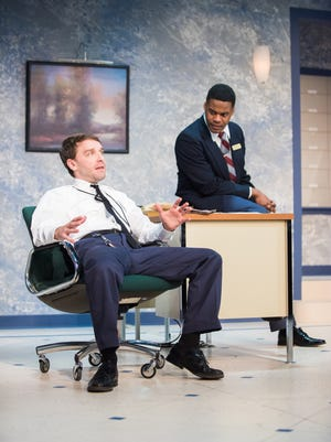 "Chris Klopatek (left) and Di'Monte Henning discuss a tricky situation in Milwaukee Chamber Theatre's production of ""Lobby Hero."""