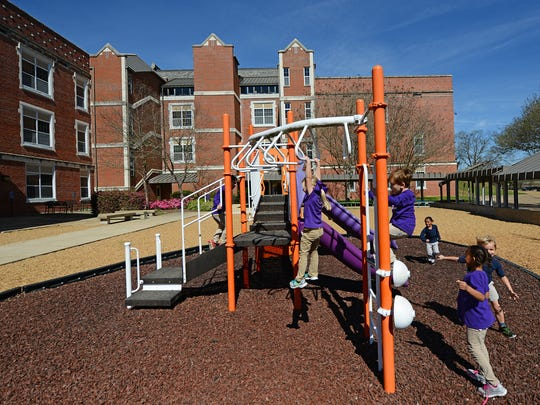 Students at NSU Elementary Lab School play outside on a playground behind Warren Easton Hall, which houses the lab school on the campus of Northwestern State University in Natchitoches.