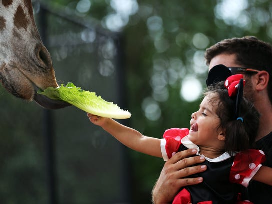 Carlos Burguillo of Naples holds his daughter Sofia,