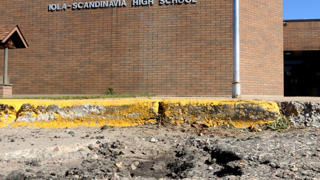 The parking lot outside Iola-Scandinavia High School was considered a loss, and needs to replaced, and would if the referendum were to pass.