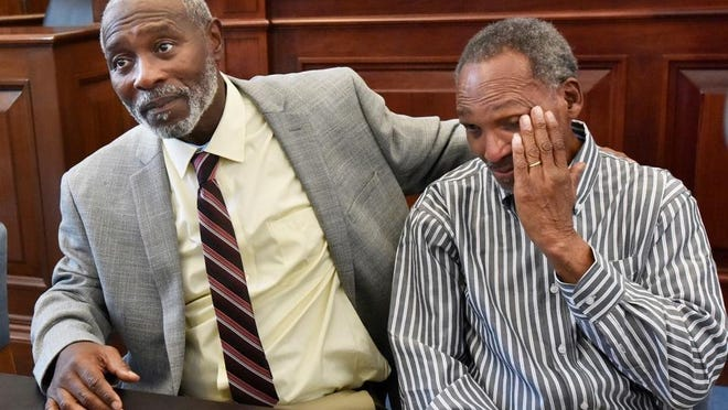 Nathan Myers (left) hugs Clifford Williams during a press conference announcing their 1976 murder convictions have been overturned Thursday in Jacksonville. The order to vacate the convictions originated from the first ever conviction integrity review unit set up by State Attorney Melissa Nelson.