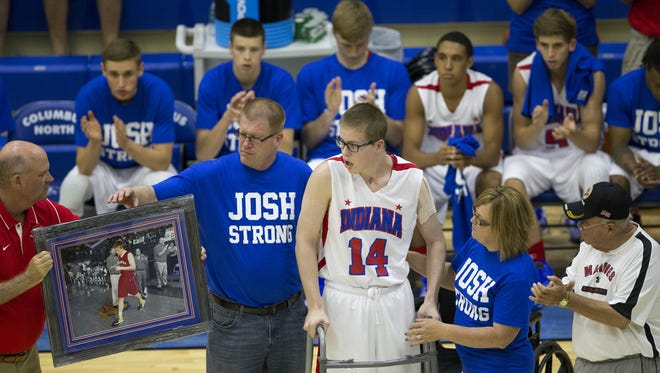 Josh Speidel, a seriously injured player for Columbus North High School, takes a few steps as he is introduced before Indiana Basketball All-Stars action against the Indiana juniors, Columbus North High School, Wednesday, June 10, 2015.