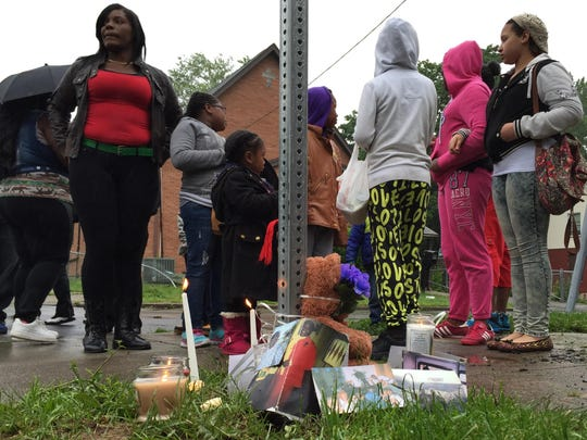 Family and friends of Richard Gregory Davis leave a memorial Monday at the scene of his death.