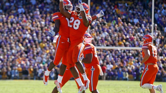 Florida linebacker Kylan Johnson (28) celebrates a fumble recovery in the first half against LSU.