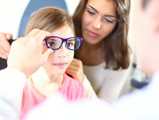 Little girl at optician's office.