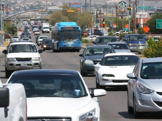 Traffic flows Friday afternoon along North Mesa Street
