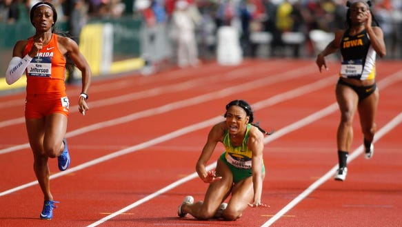 Florida's Kyra Jefferson, left, heads toward the finish