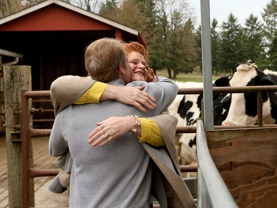 Don Sims embraces wife Tami after his Valentine's Day gift is revealed to him — a trip to a South Kitsap farm to pet a cow.
