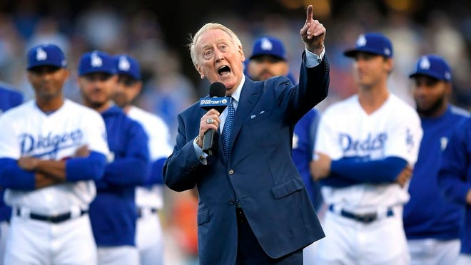 "From May 3, 2017, Los Angeles Dodgers broadcaster Vin Scully speaks during his induction into the team's Ring of Honor prior to a baseball game between the Dodgers and the San Francisco Giants in Los Angeles. Scully took a fall in his home Tuesday, April 21, 2020, and was taken to the hospital, where he was ""resting comfortably,"" the Dodgers announced Thursday, April 23. ""I won't be doing anymore headfirst sliding, I never liked it,"" the Hall of Fame broadcaster said in the team's statement posted on Twitter. Scully, 92, called Dodgers games for 67 seasons, spanning 13 National League pennants, six World Series championships, and a move across the country."