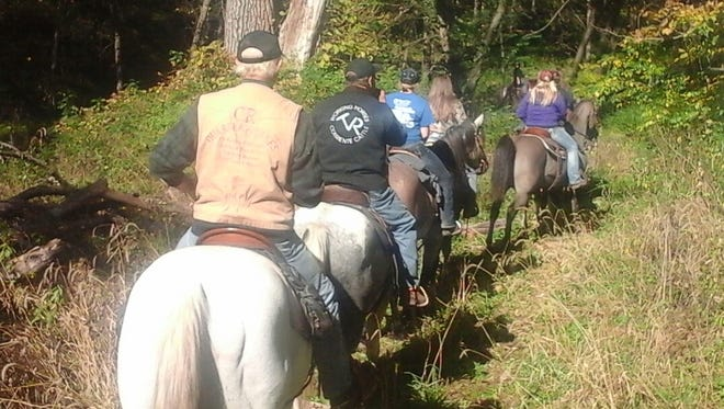 Going down the trail at the 68th Whistlin' Bit trail ride.