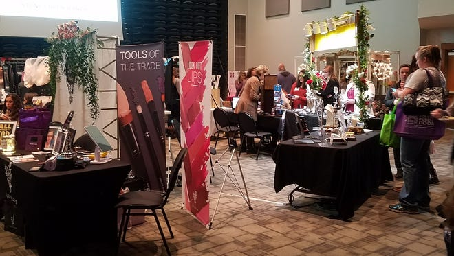 Attendees view vendor's booths during the 2017 Twin Lakes Radio Bridal Expo at The Sheid.