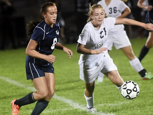 Greencastle-Antrim's Madison Uccellini (8) rushes to try to beat Shania Anderson (21) of James Buchanan to a loose ball on Thursday. The Blue Devils picked up a 2-1 victory.