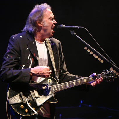 Musician Neil Young performs at the Comcast Arena in